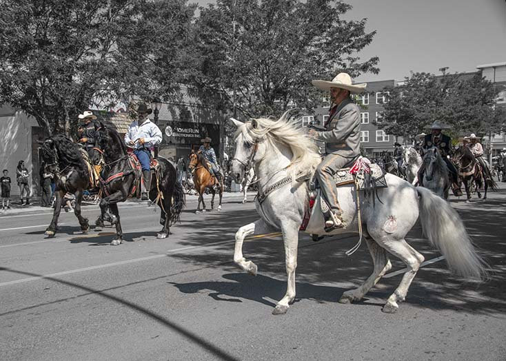 2687_Colorado_county Fair_riders-on-the-street.jpg